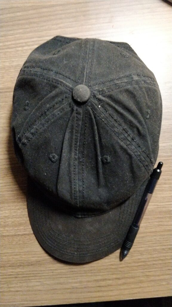 Hat with pen nerd survival guide